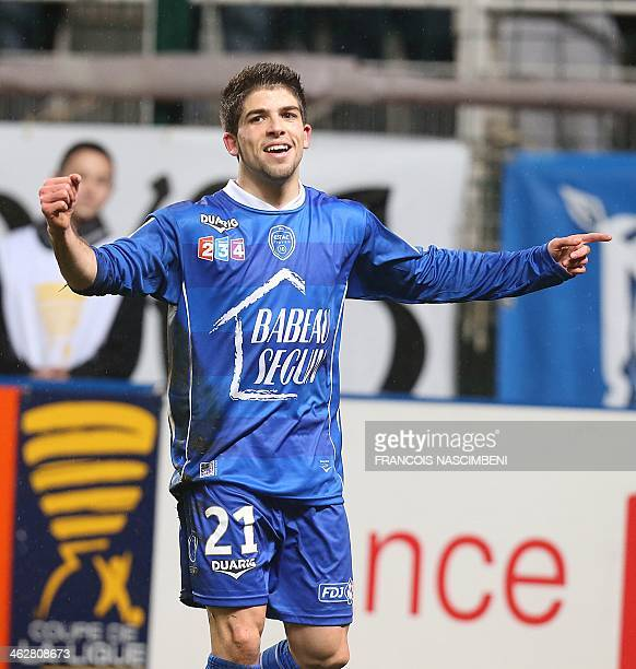 Troyes' forward Jimmy Cabot celebrates after scoring during the French League Cup quarter final football match Troyes vs Evian on January 15 2014 at...