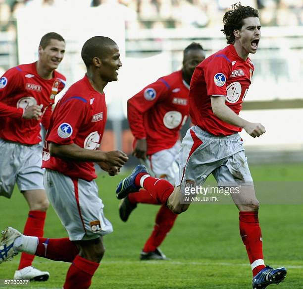 Lyon's Portuguese midfielder Tiago celebrates after scoring a goal during the French L1 football match Troyes vs Lyon 01 April 2006 at the Aube's...