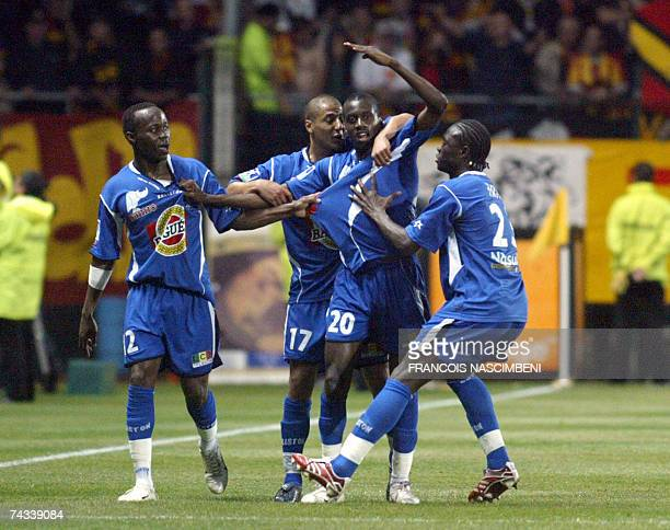 Troyes' Blaise Matuidi is congratulated by teammates after scoring a goal during the French L1 football match Troyes vs Lens 26 May 2007 at the Aube...