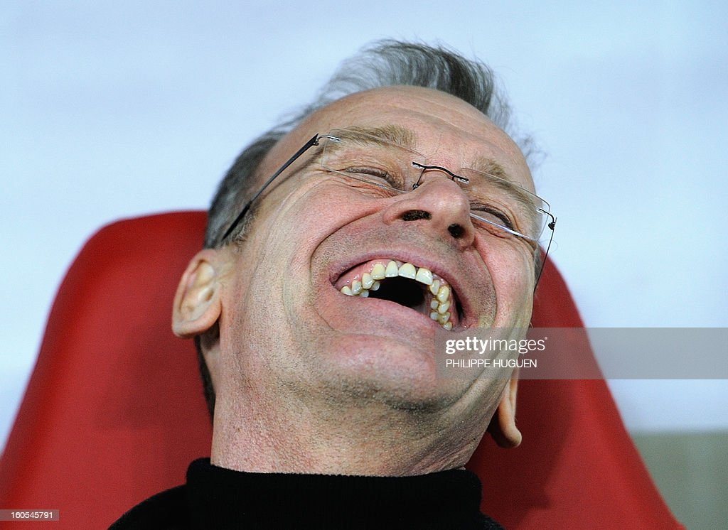 Troyes' French coach Jean-Marc Furlan laughs during the French L1 football match Lille vs Troyes on February 2, 2013 at the Grand Stade Stadium in Villeneuve d'Ascq. AFP PHOTO PHILIPPE HUGUEN