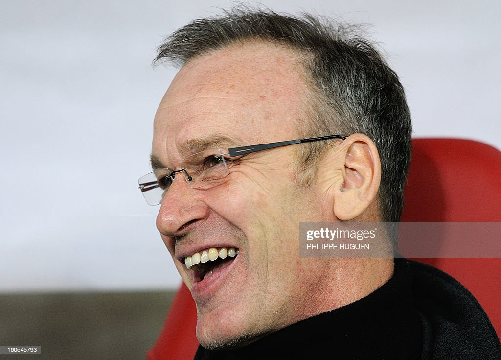 Troyes' French coach Jean-Marc Furlan smiles during the French L1 football match Lille vs Troyes on February 2, 2013 at the Grand Stade Stadium in Villeneuve d'Ascq.