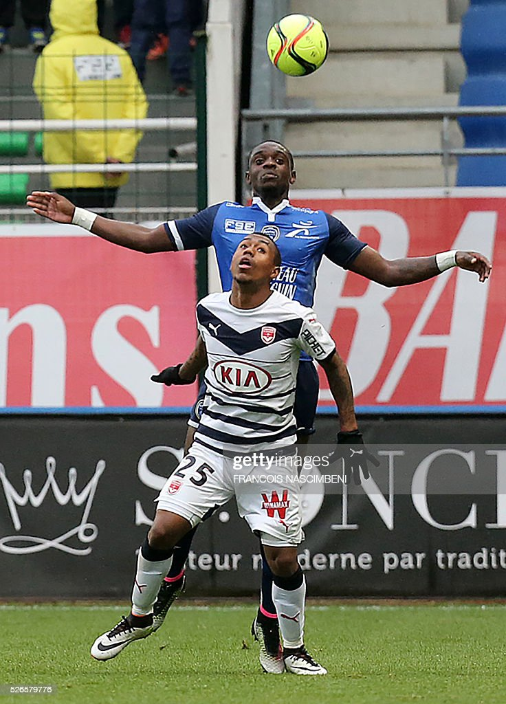 Troyes' French defender Chris Mavinga (up) vies for the ball with Bordeaux' forward Malcom (down) during the French L1 football match between Troyes (ESTAC) and Bordeaux (FCGB) on April 30, 2016 at the Aube Stadium in Troyes, eastern France.