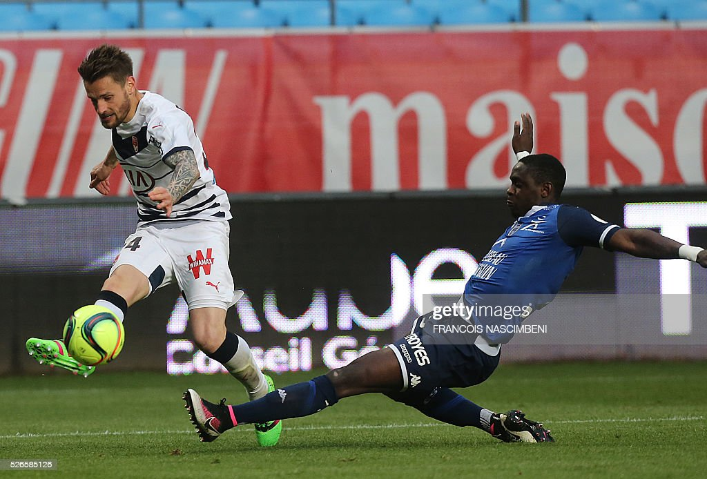 Troyes' French defender Chris Mavinga (R) vies for the ball with Bordeaux' French defender Mathieu Debuchy (L) during the French L1 football match between Troyes (ESTAC) and Bordeaux (FCGB) on April 30, 2016 at the Aube Stadium in Troyes, eastern France.
