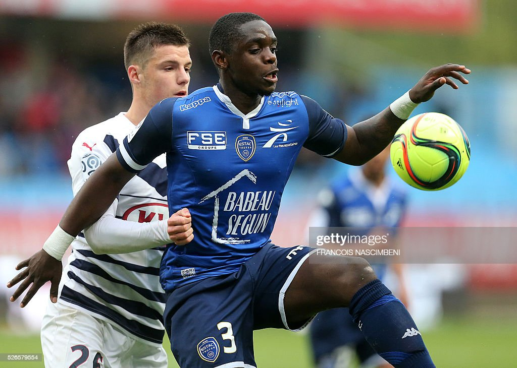 Troyes' French defender Chris Mavinga (R) vies for the ball with Bordeaux's French defender Frederic Guilbert (L) during the French L1 football match between Troyes (ESTAC) and Bordeaux (FCGB) on April 30, 2016 at the Aube Stadium in Troyes, eastern France.