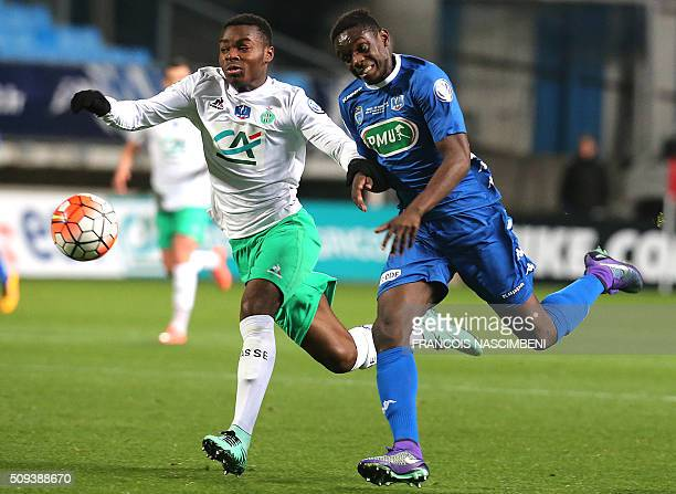 Troyes' French defender Chris Mavinga vies with SaintEtienne's defender RupertNathan Dekoke during the French Cup football match between Troyes and...