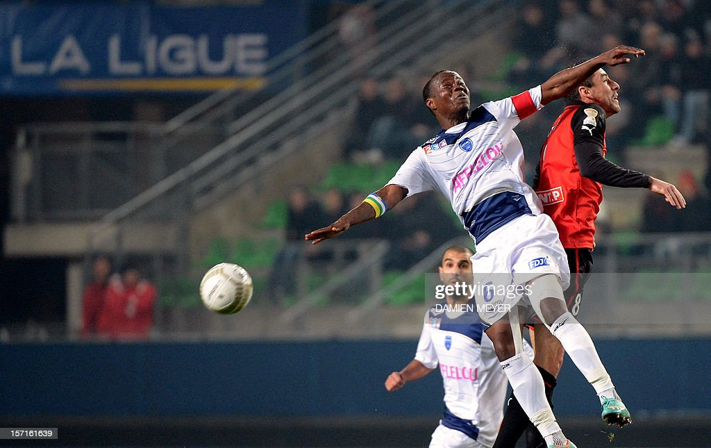 Troyes' French defender Eloge Enza-Yamissi (L) fights for the ball with Rennes' French midfielder Julien Feret during the French cup football match Rennes against Troyes on November 29 , 2012 at the route de Lorient stadium in Rennes, western France.