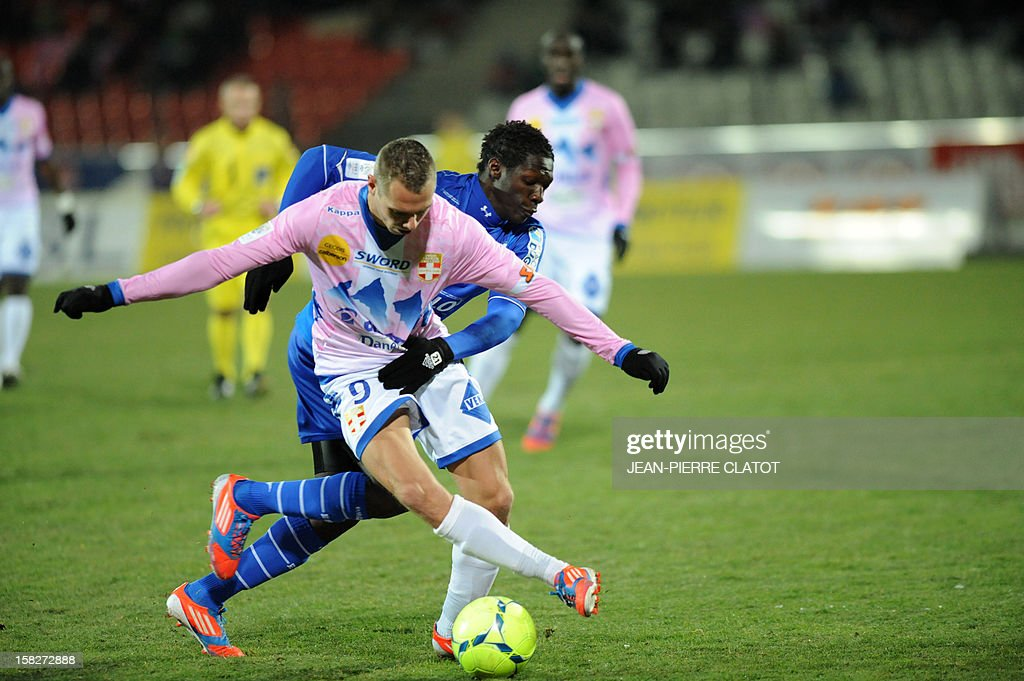 Troyes' French defender Fabrice Nsakala (R) vies for the ball with Evian's French forward Kevin Berigaud during the French L1 football match Evian (ETGFC) vs Troyes (ESTAC) on December 12, 2012 at the Parc des Sports stadium in Annecy, eastern France. AFP PHOTO / JEAN-PIERRE CLATOT