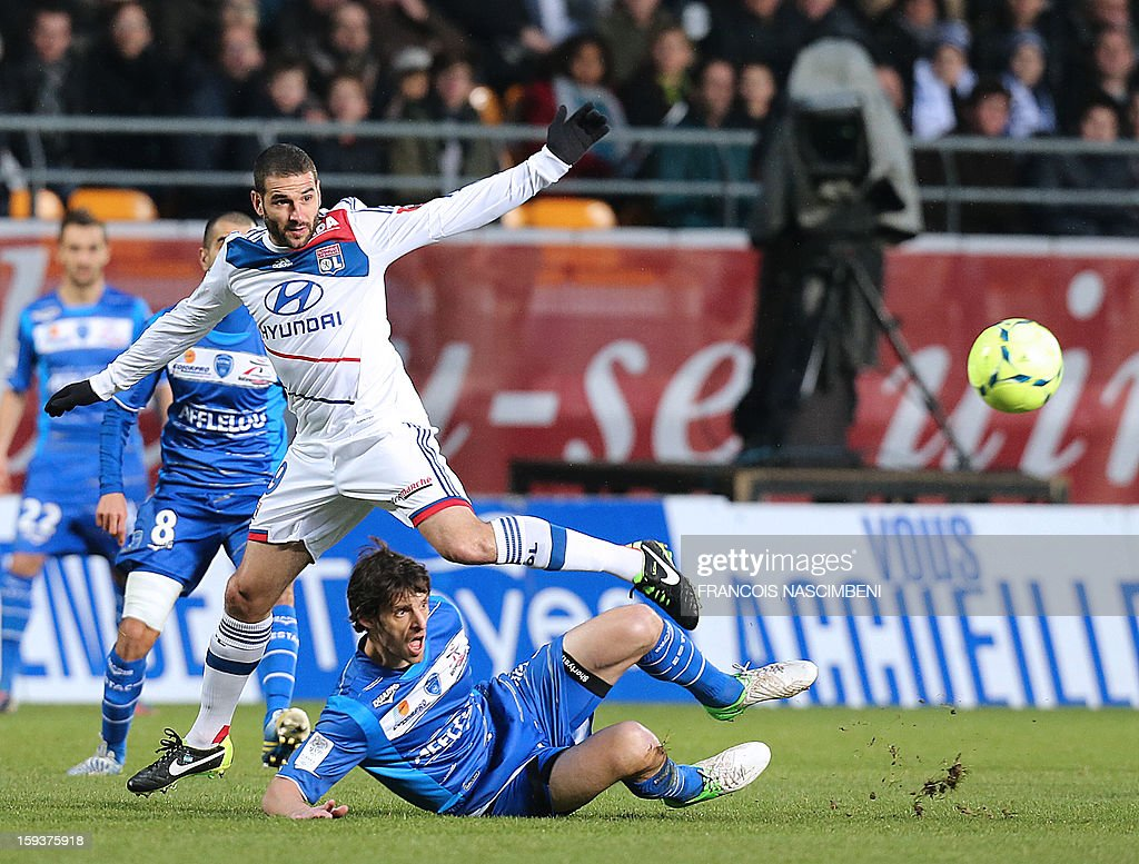 Troyes' French defender Jérémie Brechet (R) vies with Lyon's forward Lisandro Lopez (L) during a French L1 football match between Troyes and Lyon on January 12, 2013 at the Aube Stadium in Troyes. PHOTO