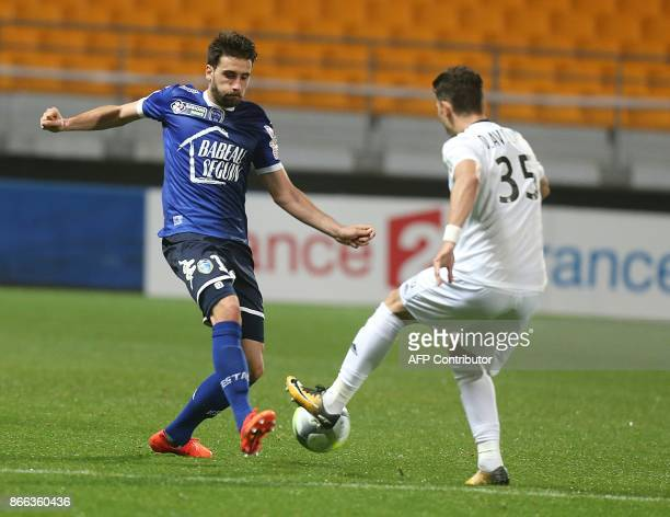 Troyes' French defender Mathieu Deplagne vies with Amiens' midfielder Fernando Avelar during the Ligue Cup Football match between Troyes and Amiens...