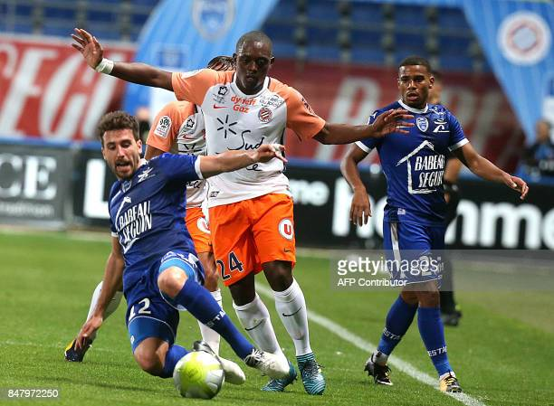 Troyes' French defender Mathieu Deplagne vies with Montpellier's French defender Jerome Roussillon during the French Ligue 1 football match between...