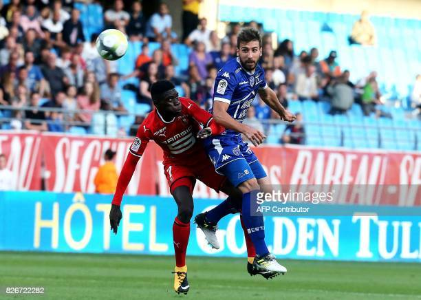 Troyes French defender Mathieu Deplagne vies with Rennes' forward Ismaila Sarr during the French L1 football match between Troyes and Rennes on...