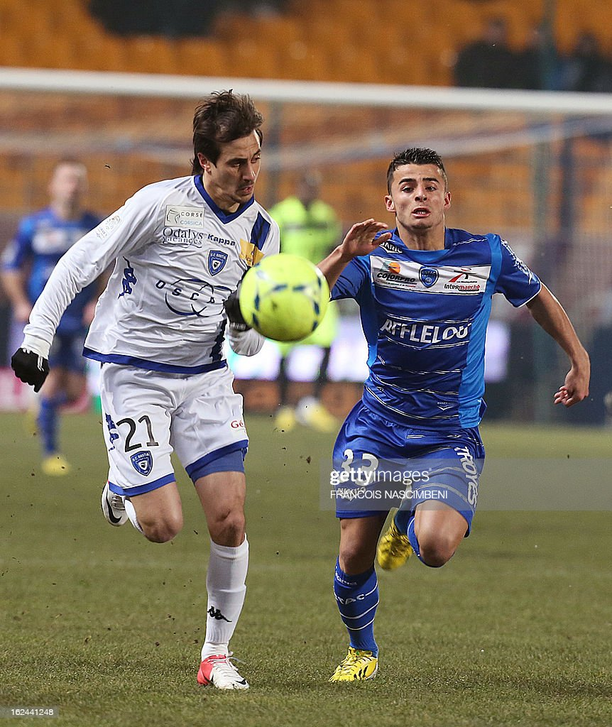 Troyes' French forward Jean Corentin (R) vies with Bastia's Algerian defender Fethi Harek (L), on February 23, 2013 during the French L1 football match Troyes vs Bastia in the Aube Stadium in Troyes. PHOTO