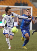 Troyes' French forward Jean Corentin vies with Bastia's Algerian defender Fethi Harek on February 23 2013 during the French L1 football match Troyes...