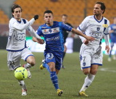 Troyes' French forward Jean Corentin vies with Bastia's Algerian defender Fethi Harek and Bastia's French defender Sylvain Marchal on February 23...