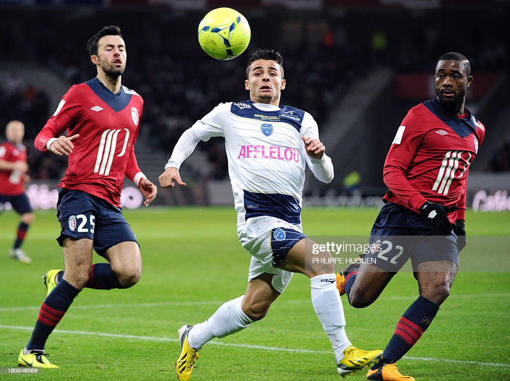 Troyes' French forward Jean Corentin (C) vies with Lille's Montenegrin defender Marko Basa (L) and Cameroonian midfielder Aurelien Chedjou during the French L1 football match Lille vs Troyes on February 2, 2013 at the Grand Stade Stadium in Villeneuve d'Ascq.
