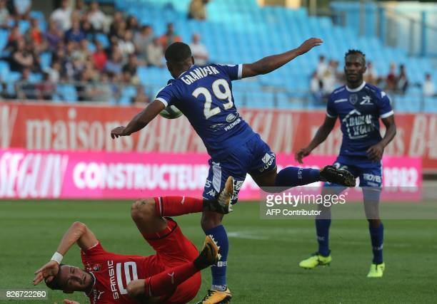 Troyes' French forward Samuel Grandsir vies with Rennes' Algerian defender Rami Bensebaini during the French Ligue 1 football match between Troyes...