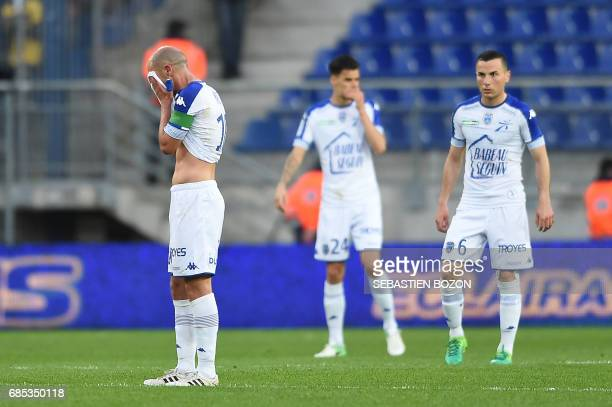 Troyes' French midfielder Benjamin Nivet gestures after FC Sochaux' French defender Florent Ogier scores a goal during the French L2 football match...