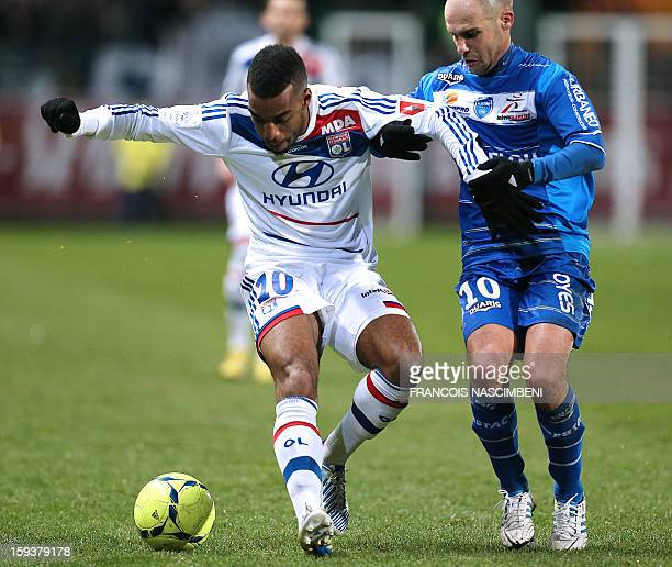 Troyes' French midfielder Benjamin Nivet vies with Lyon's midfielder Alexandre Lacazette during a French L1 football match between Troyes and Lyon on...