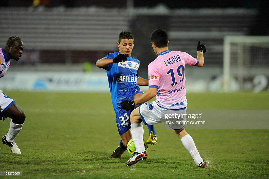 Troyes' French midfielder Corentin Jean vies with Evian's French midfielder Guillaume Lacour during their French L1 football match Evian (ETGFC) vs Troyes (ESTAC) december 12, 2012 at the city stadium Parc des sports in Annecy, eastern France.