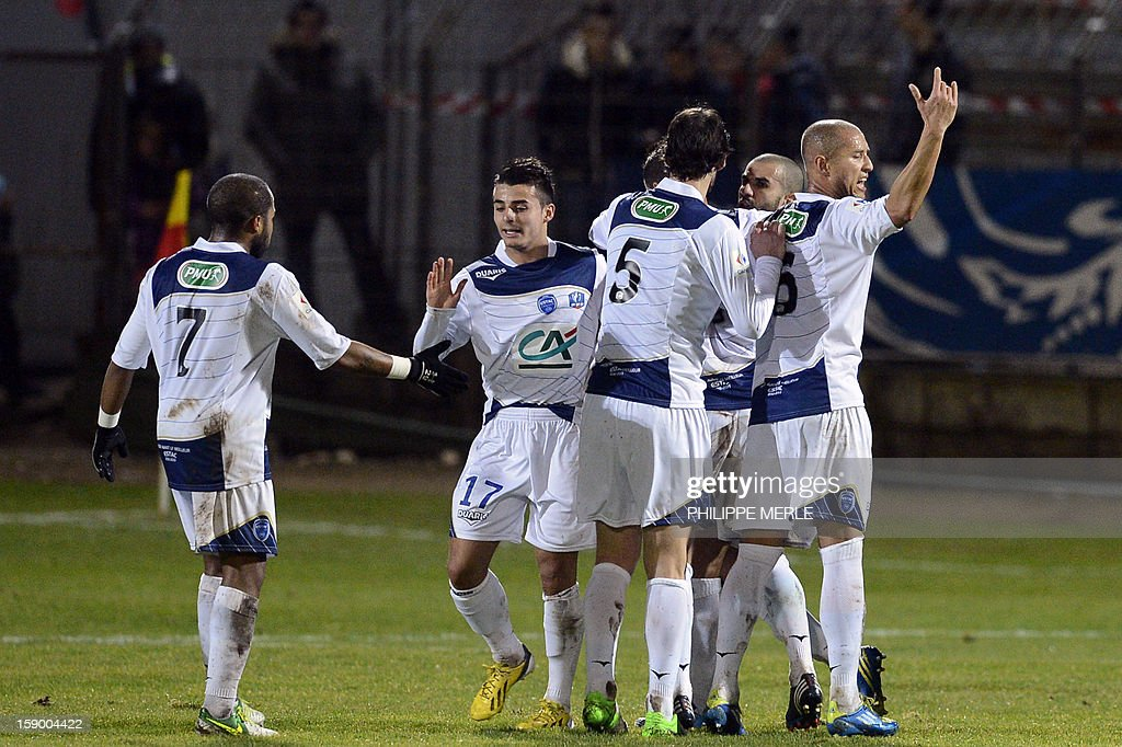 Troyes' French midfielder Fabien Camus (2L) is congratulated by his teammates after scoring a goal during the French Cup football match Montceau vs Troyes, on January 5, 2013 at the Alouette stadium in Montceau-les- Mines.