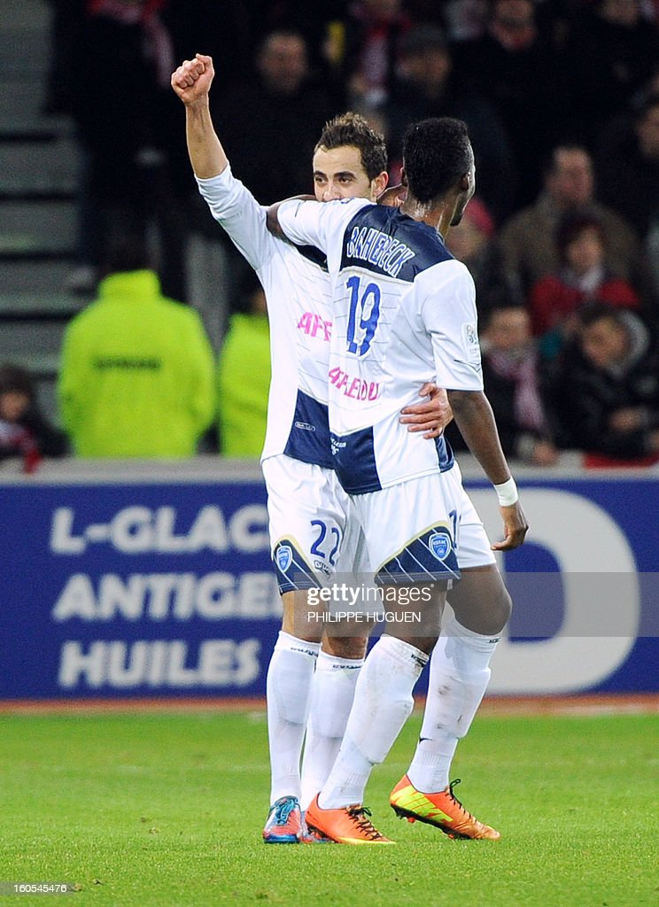 Troyes' French midfielder Fabien Camus (L) is congratuled by a team mate after scoring a goal during a French L1 football match between Lille and Troyes on February 2, 2013 at Grand Stade in Villeneuve d'Ascq.