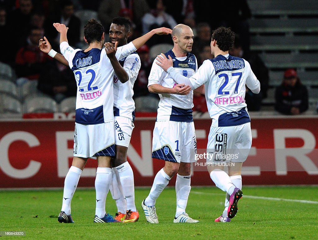 Troyes' French midfielder Fabien Camus (L) is congratuled by team mates after scoring a goal during a French L1 football match between Lille and Troyes on February 2, 2013 at Grand Stade in Villeneuve d'Ascq.