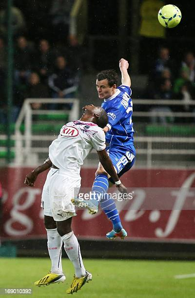 Troyes' French midfielder Julien Faussurier vies for the ball with Bordeaux's Malian midfielder Abdou Traore during the French L1 football match...