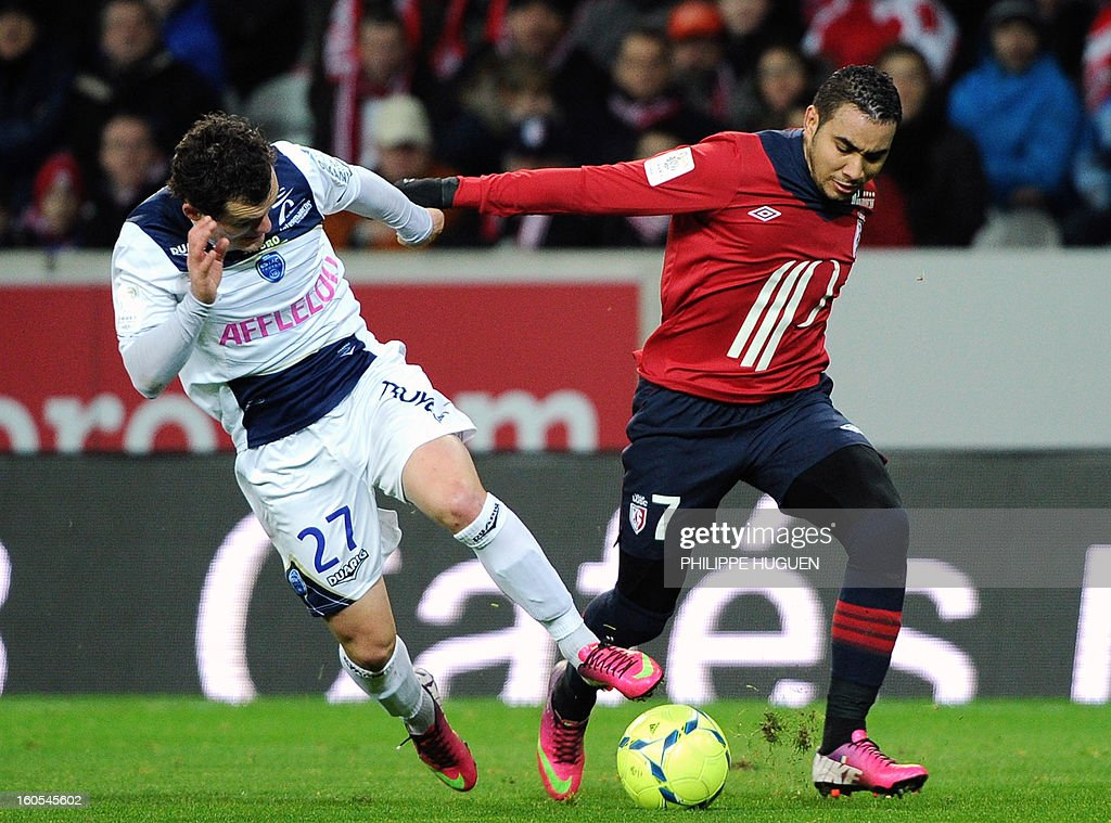 Troyes' French midfielder Julien Faussurier (L) vies with Lille's French forward Dimitri Payet during the French L1 football match Lille vs Troyes on February 2, 2013 at the Grand Stade Stadium in Villeneuve d'Ascq.