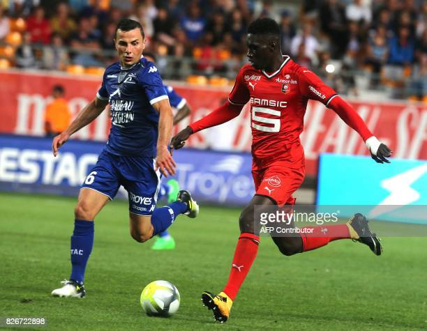 Troyes' French midfielder Karim Azamoum vies with Rennes' forward Ismaila Sarr during the French Ligue 1 football match between Troyes and Rennes on...