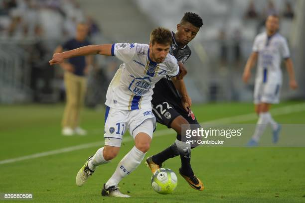 Troyes' French midfielder Mathieu Deplagne vies with Bordeaux's Brazilian forward Jonathan Cafu during the French Ligue 1 football match between...