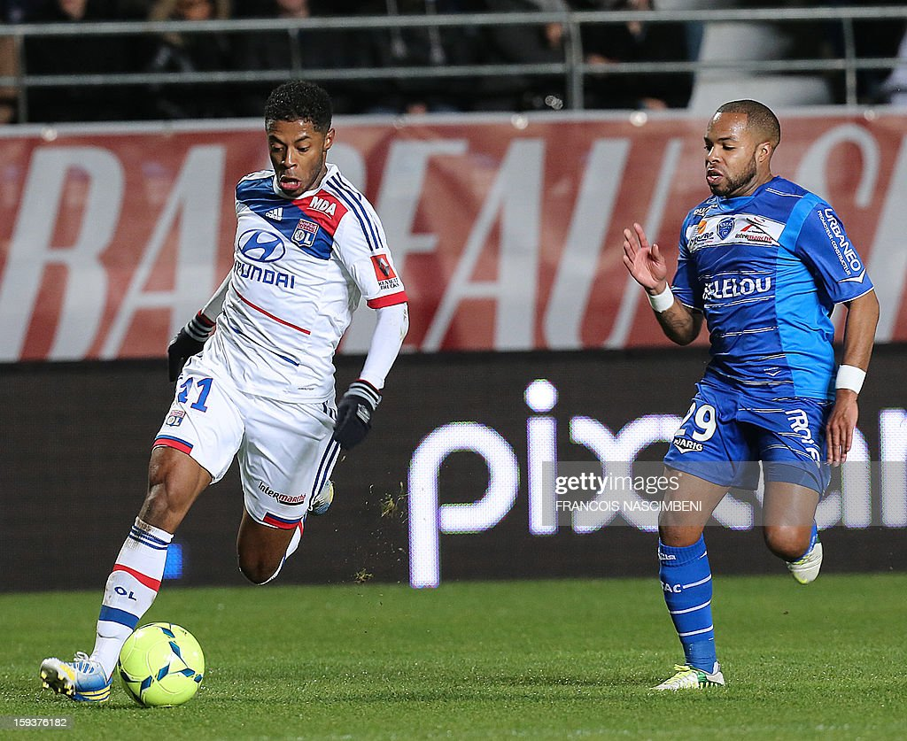 Troyes' French midfielder Quentin Othon (R) vies for the ball with Lyon's midfielder Bastos (L) during the French L1 football match between Troyes and Lyon on January 12, 2013, at the Aube Stadium in Troyes.