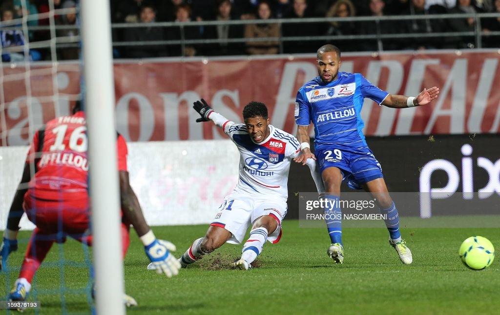 Troyes' French midfielder Quentin Othon (R) vies with Lyon's midfielder Bastos (center) during a French L1 football match between Troyes and Lyon on January 12, 2013 at the Aube Stadium in Troyes.