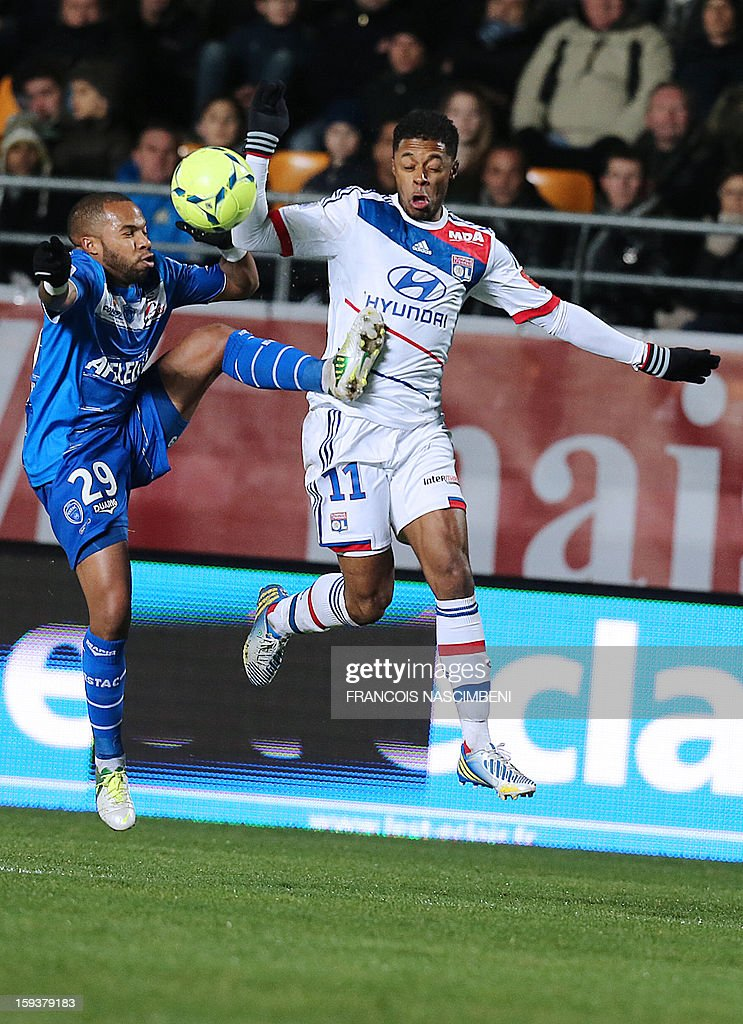 Troyes' French midfielder Quentin Othon (L) vies with Lyon's midfielder Bastos during a French L1 football match between Troyes and Lyon on January 12, 2013 at the Aube Stadium in Troyes.