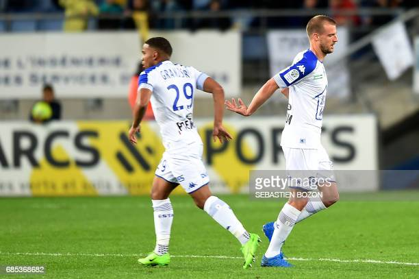 Troyes' French midfielder Stephane Darbion celebrates after scoring a goal during the French L2 football match Sochaux versus Troyes on May 19 2017...