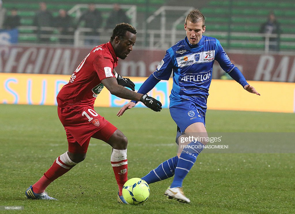 Troyes' French midfielder Stephane Darbion (R) vies Brest's Guinean forward Larsen Toure (L) during the French L1 football match Troyes vs Brest on January 26, 2013 at the Aube stadium in Troyes. PHOTO
