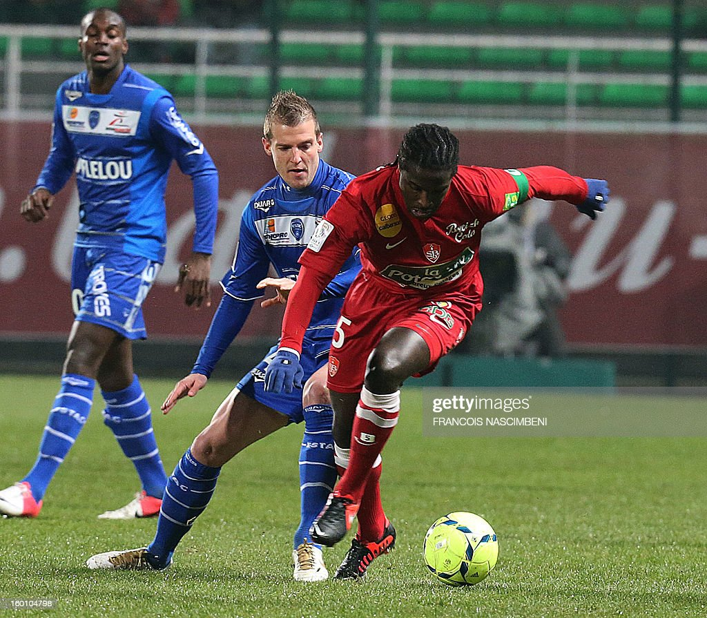 Troyes' French midfielder Stephane Darbion (C) vies with Brest's French defender Bernard Mendy (R) during the French L1 football match Troyes vs Brest on January 26, 2013 at the Aube stadium in Troyes. PHOTO