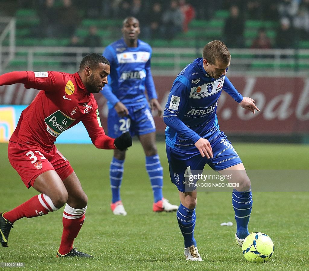 Troyes' French midfielder Stephane Darbion (R) vies with Brest's midfielder Andre Auras (L) during the French L1 football match Troyes vs Brest on January 26, 2013 at the Aube stadium in Troyes. PHOTO