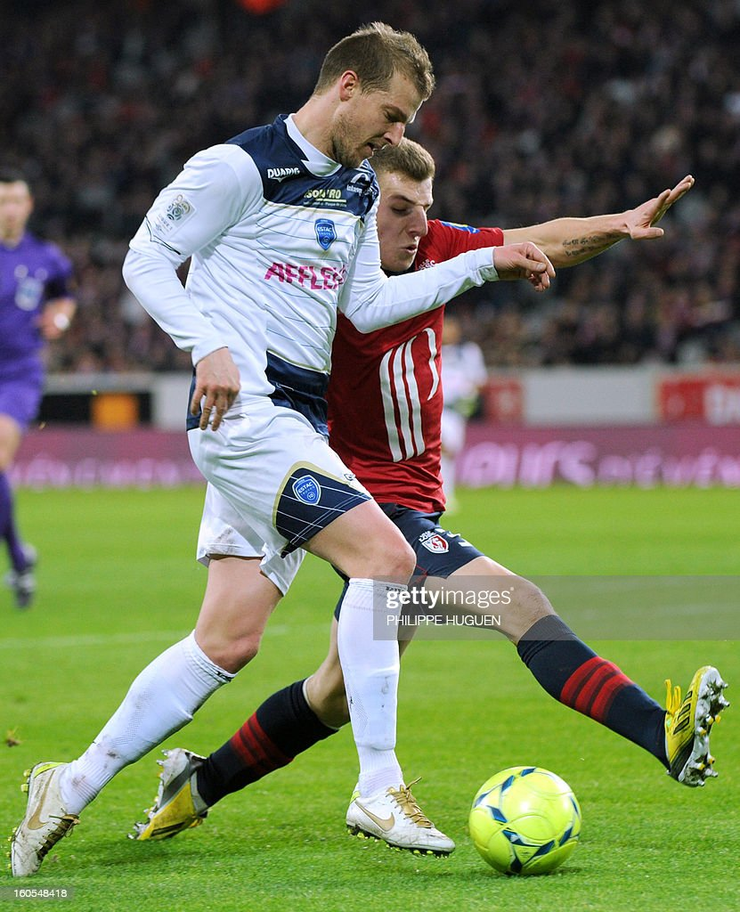 Troyes' French midfielder Stephane Darbion (L) vies with Lille's French defender Lucas Digne during the French L1 football match Lille vs Troyes on February 2, 2013 at the Grand Stade Stadium in Villeneuve d'Ascq.