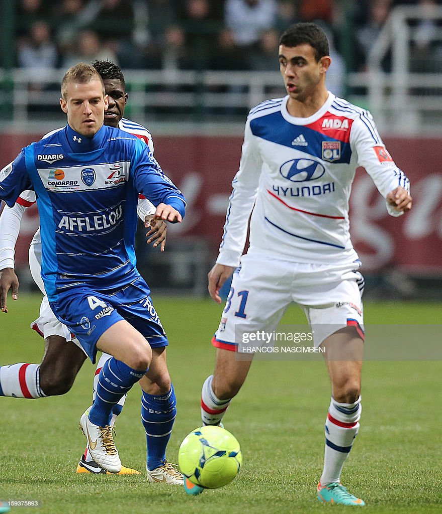 Troyes' French midfielder Stephane Darbion (L) vies with Lyon's forward Rachid Ghezzal (R) during a French L1 football match between Troyes and Lyon on January 12, 2013 at the Aube Stadium in Troyes.