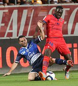 Troyes' French midfielder Yoann Court vies with Ajaccio's midfielder Amos Youga during the French L1 football match between Troyes and Ajaccio at...