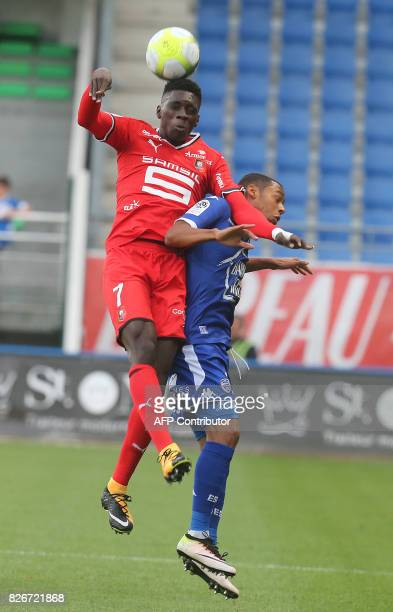 Troyes' Gabonese defender Johann Obiang vies with Rennes' forward Ismaila Sarr during the French L1 football match between Troyes and Rennes on...