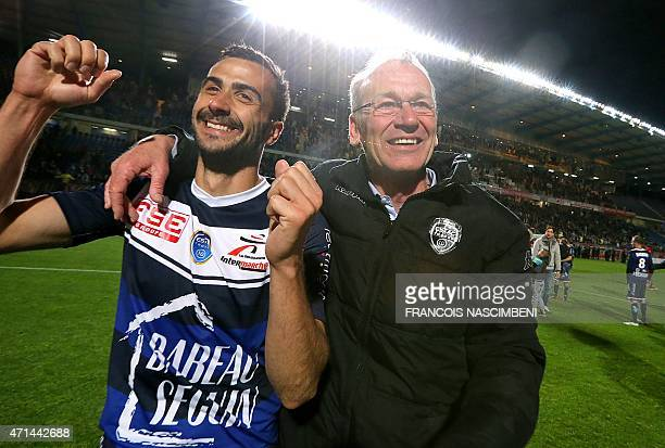 Troyes' head coach JeanMarc Furlan and Troyes' defender Matthieu Saunier celebrate after Troyes won the French L2 football match against Angers at...