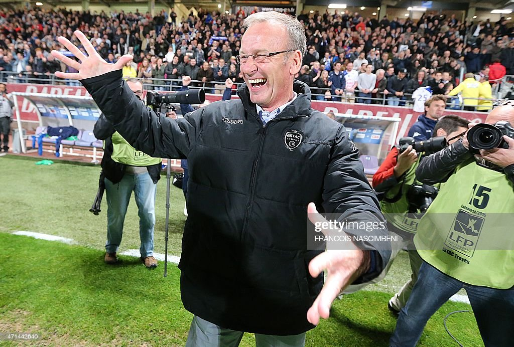 Troyes' head coach Jean-Marc Furlan celebrates after his team won the French L2 football match against Angers at the Aube Stadium in Troyes on April 28, 2015.