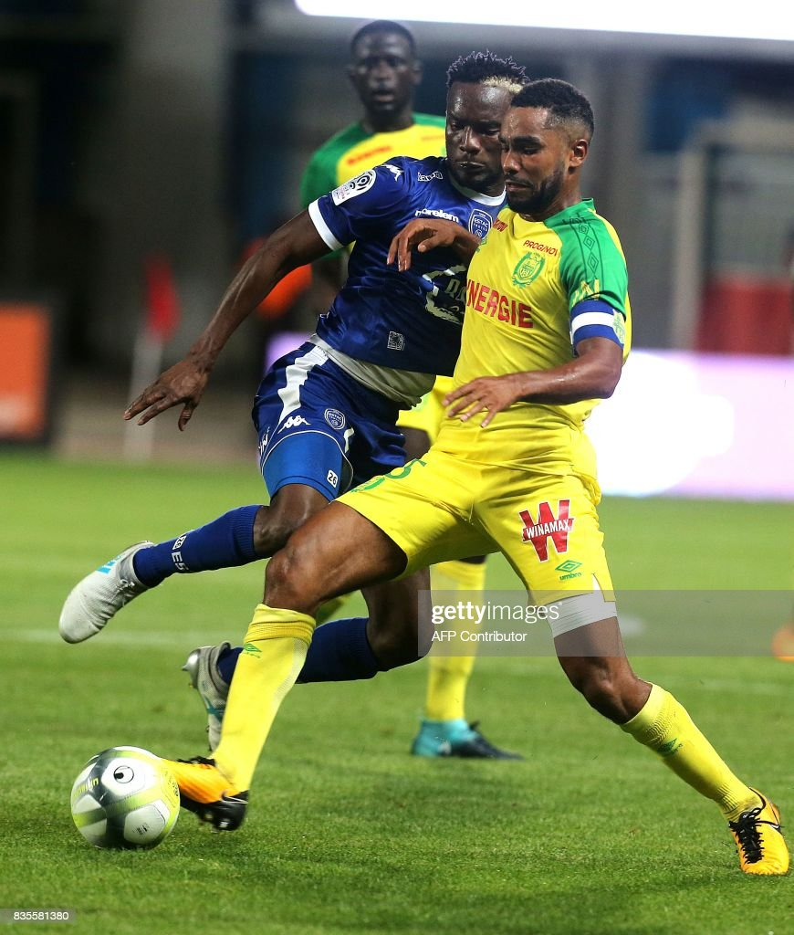 Troyes' Malian forward Adama Niane (L) vies with Nantes' French defender Koffi Djidji (R) during the French L1 football match between Troyes (ESTAC) and Nantes (FCN) on August 19, 2017, at the Aube stadium in Troyes, eastern France. /