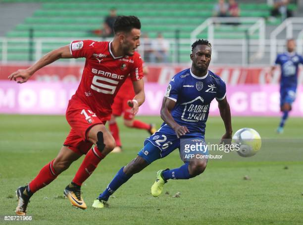 Troyes' Malian forward Adama Niane vies with Rennes' Algerian defender Rami Bensebaini during the French L1 football match between Troyes and Rennes...