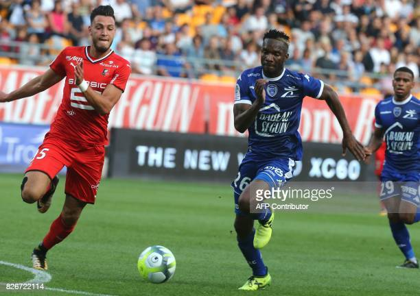 Troyes' Malian forward Adama Niane vies with Rennes' Algerian defender Rami Bensebaini during the French Ligue 1 football match between Troyes and...