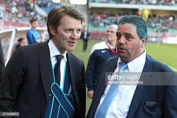 Troyes' mayor François Baroin and Troyes' president Daniel Masoni talk prior to the French Football match between Troyes and Chateauroux on May 22...