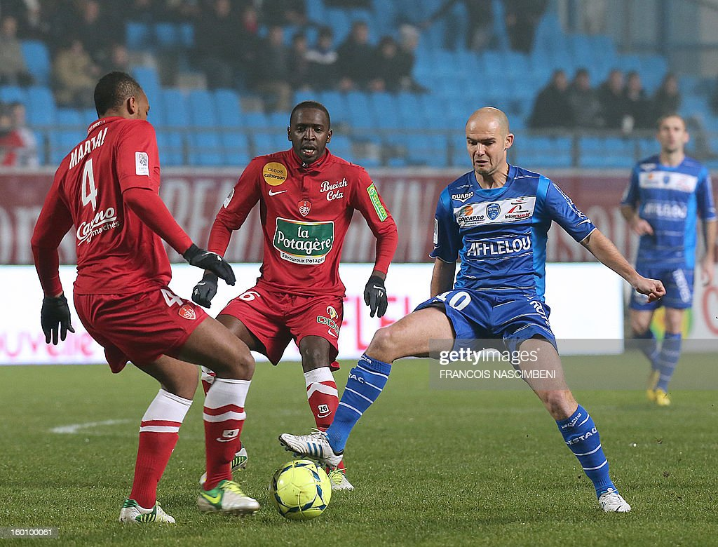 Troyes' midfielder Benjamin Nivet (R) vies with Brest's French midfielder Abdoulwhaid Sissoko (C) and Brest's French defender Johan Martial (L) during the French L1 football match Troyes vs Brest on January 26, 2013 at the Aube stadium in Troyes. PHOTO FRANCOIS NASCIMBENI