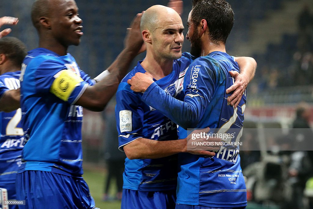 Troyes' midfielder Fabien Camus (R) is congratulated by Troyes' midfielder Benjamin Nivet and Troyes captain Eloge Enza Yamissi after scoring a goal during the French L1 football match Troyes vs Brest on January 26, 2013 at the Aube stadium in Troyes. PHOTO