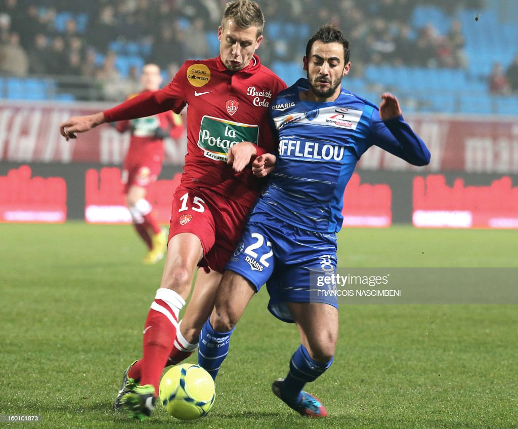Troyes' midfielder Fabien Camus (R) vies with Brest's defender Florian Lejeune (L) during the French L1 football match Troyes vs Brest on January 26, 2013 at the Aube stadium in Troyes. PHOTO